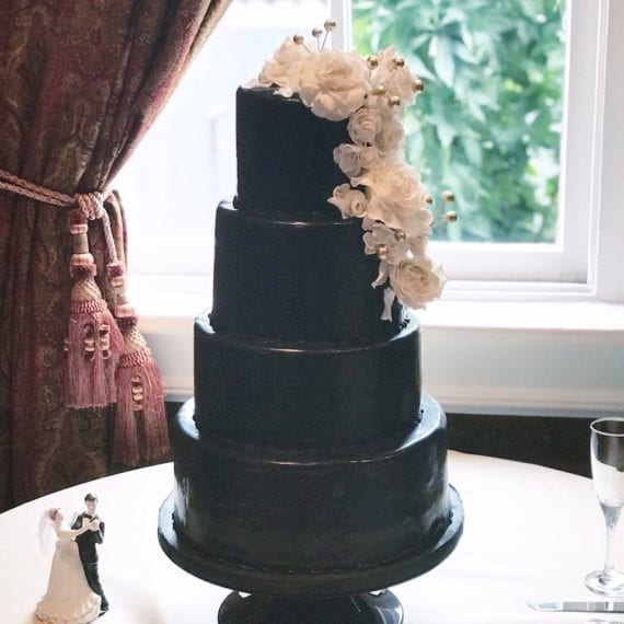 Black Fondant Wedding Cake with White Flowers